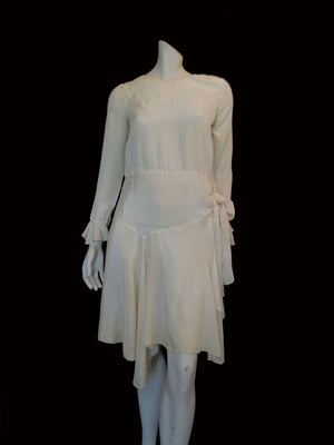 vintage 1920s cream silk dress with asymmetric hem and long sleeves