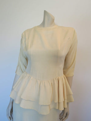 cream grosgrain peplum dress by mark shaw vintage 1980s