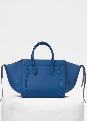 330d0b0877 The Céline Phantom tote is a larger and wider version of the Céline Mini  Luggage Tote. One of its noticeable characteristic is that the bag has a  much ...