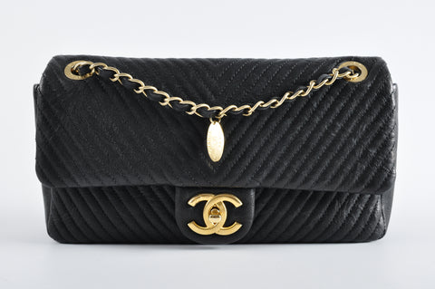8d1b398945bf6d Chanel Black Chevron Calf Leather Flap in GHW - Glampot