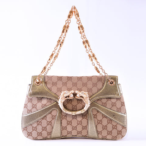cc94a80b451 Previous. Gucci Limited Edition Gold GG Canvas Tom Ford Dragon Shoulder Bag