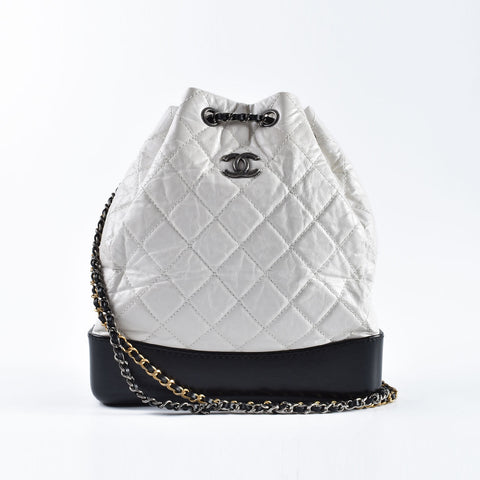 Chanel Gabrielle Small Quilted White Aged Calfskin / Black leather Bagpack - Glampot