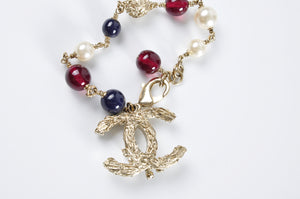 Chanel Beaded Pearl CC Bracelet Blue Red Gold - Glampot
