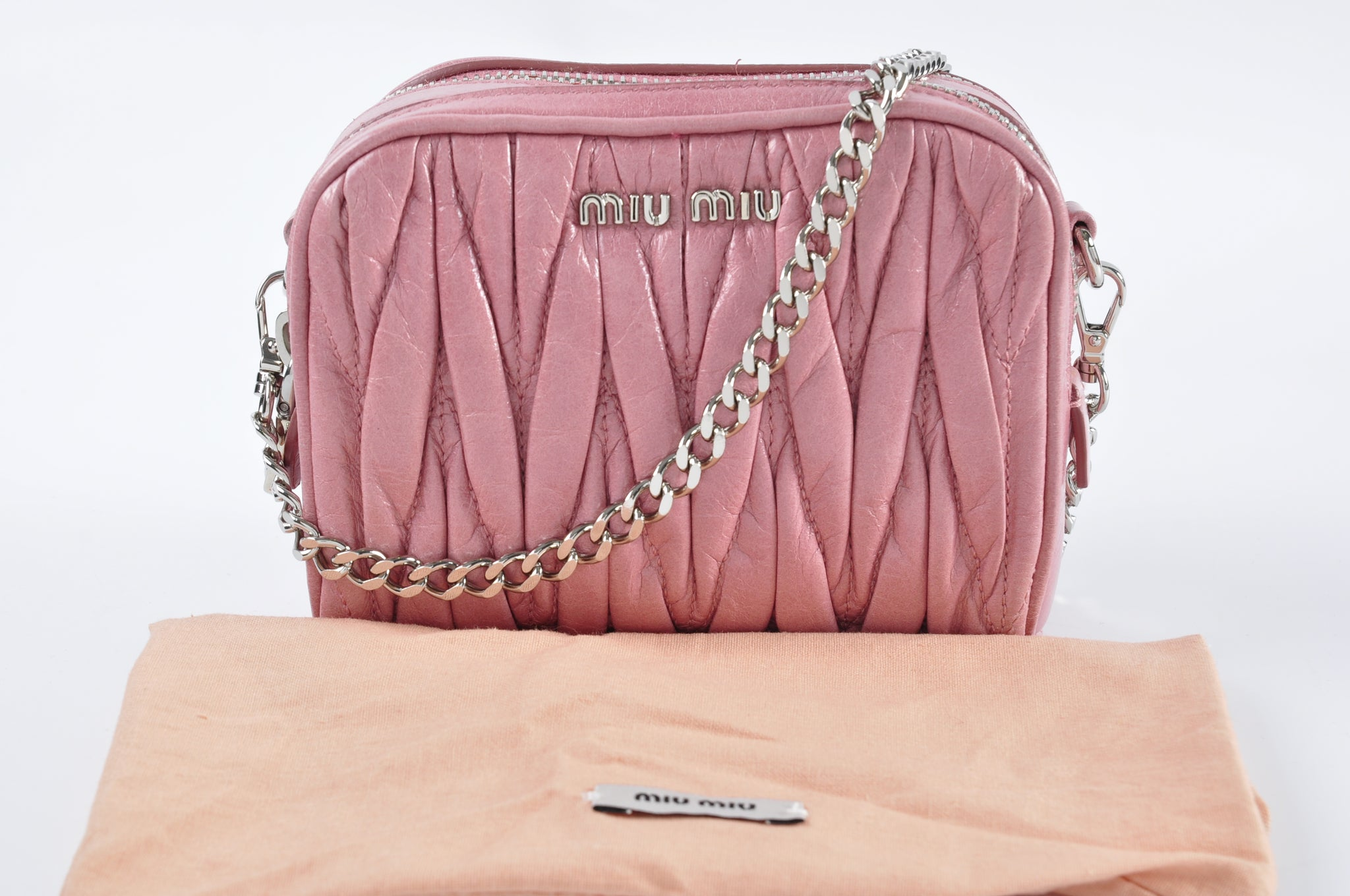 573cd590088d Miu Miu Women s Pink Matelassé Leather Mini Crossbody Bag SHW – Glampot