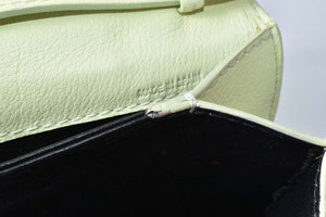 M2Malletier La Fleur Du Mal leather clutch in Lemonade
