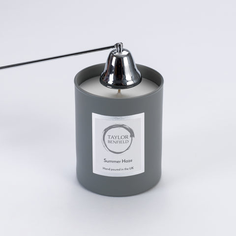 Taylor Benfield candle accessories - candle snuffer in use