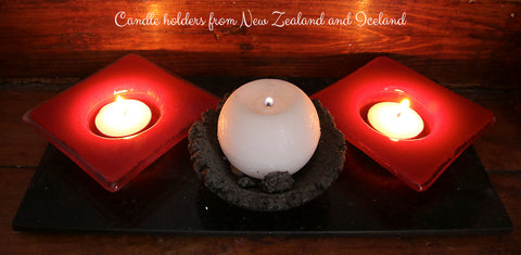 Glass candle holders from New Zealand and candle holder made from Volcanic rock, Iceland