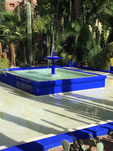 Fountain inside the Jardin Marjorelle in Marrakech with it's striking blue design