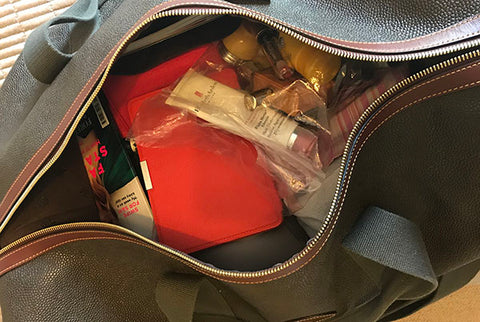 Packed bag ready to be zipped - top tips on packing blog from Taylor Benfield