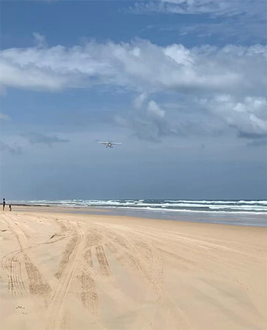 Plane landing on Fraser Island, Taylor Benfield blog