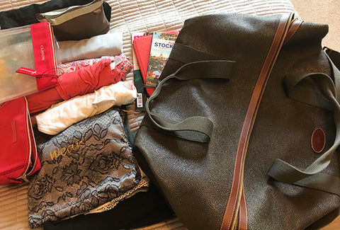 Bag ready to be packed for a weekend away - Top Tips from Taylor Benfield