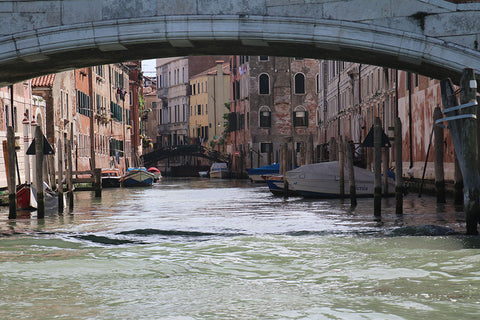 Appearing under a bridge into the heart of Venice
