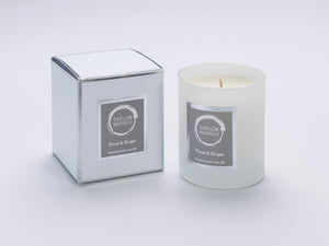 Taylor Benfield Floral & Ginger luxury scented home candle beautifully packaged in white matte glass, with a white branded box.