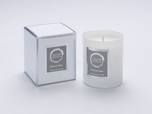 Taylor Benfield Summer Haze luxury scented home candle beautifully packaged in white matte glass, with a white branded box.