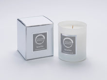 Taylor Benfield Spiced Noir luxury scented home candle beautifully packaged in white matte glass, with a white branded box.
