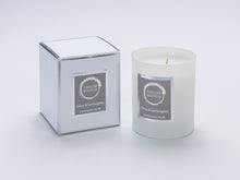 Taylor Benfield Citrus & Lemongrass luxury scented home candle beautifully packaged in white matte glass, with a white branded box.