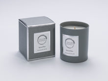 Taylor Benfield Spiced Noir luxury scented home candle beautifully packaged in grey matte glass, with a grey branded box. Perfect candles for men.