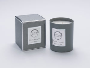 Taylor Benfield Citrus & Lemongrass luxury scented home candle beautifully packaged in grey matte glass, with a grey branded box.