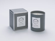 Taylor Benfield Summer Haze luxury scented home candle beautifully packaged in grey matte glass, with a grey branded box.