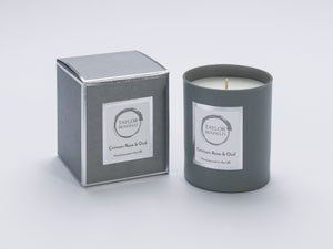 Taylor Benfield Crimson Rose & Oud luxury scented home candle beautifully packaged in grey matte glass, with a grey branded box.