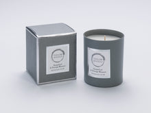Taylor Benfield Grapefruit & Orange Blossom luxury scented home candle beautifully packaged in grey matte glass, with a grey branded box.