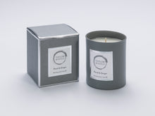 Taylor Benfield Floral & Ginger luxury scented home candle beautifully packaged in grey matte glass, with a grey branded box.