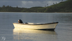 Lone boat on the sea in Fiji - Taylor Benfield Luxury Scented Grapefruit & Orange Blossom Candle