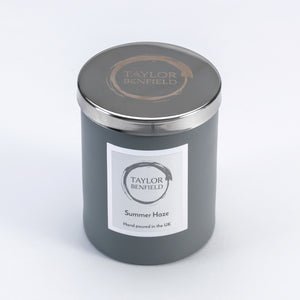 Taylor Benfield stylish signature candle lid is a gorgeous accessory for your home candle, pictured on a grey Summer Haze luxury scented candle.