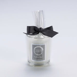 Taylor Benfield Summer Haze luxury scented travel candle beautifully packaged in clear glass, wrapped with a grey ribbon.