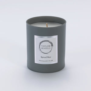 Taylor Benfield Spiced Noir luxury scented home candle beautifully packaged in grey matte glass. Perfect man candles.