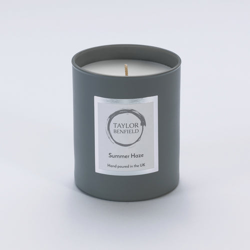 Taylor Benfield Summer Haze luxury scented home candle beautifully packaged in grey matte glass.