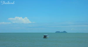 Lone boat on the sea near Ko Samui - Taylor Benfield Luxury Scented Citrus & Lemongrass Candle