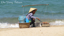 Vietnamese lady cooking lobster on a beach in Nha Trang - Taylor Benfield Luxury Scented Crimson Rose & Oud Candle
