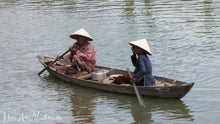 Two vietnamese people in a boat in Hoi An - Taylor Benfield Luxury Scented Crimson Rose & Oud Candle