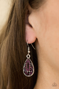 Varying in size, glittery purple rhinestones are sprinkled along a silver teardrop, creating a regal lure
