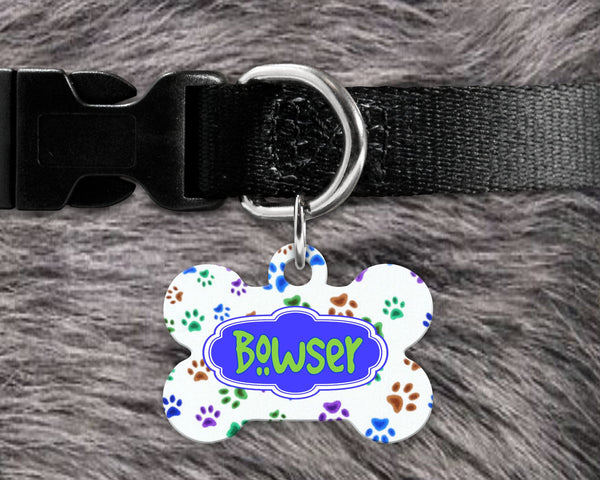 Dog, pet tags, paws background design on bone shaped tag- customize with name and owner contact information