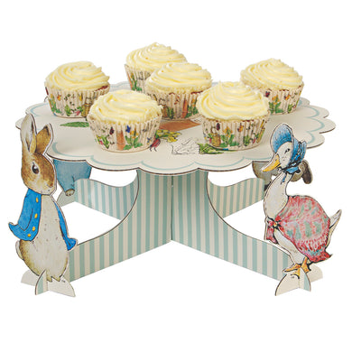 Though Peter Rabbit is now well over 100 years old, Beatrix Potter's charming creation is as beloved as ever, making him and his friends the perfect special guests for any celebration. That's why they feature on this beautiful cupcake stand, featuring Beatrix Potter's classic illustrations, and four stand-up characters. Simply load with cupcakes for the perfect centerpiece for your party!   Assembled size: 360mm x 180mm x 360mm