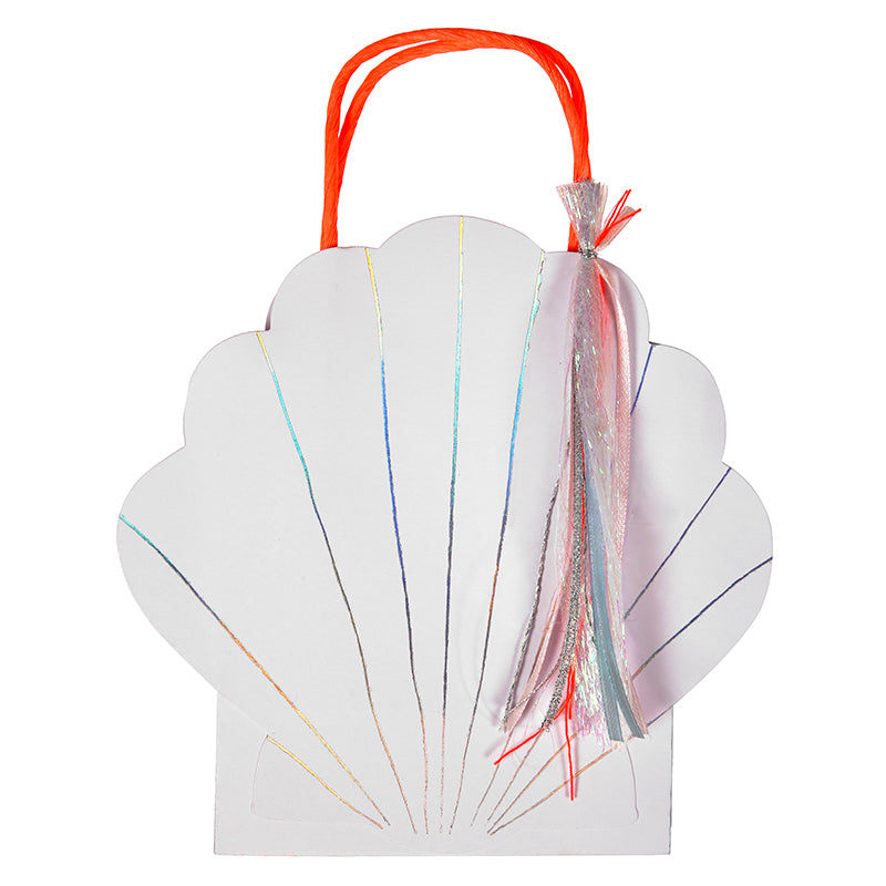 After an undersea party complete with mermaids give your little guests their goodies in these cute shell party bags. Each bag is embellished with shiny silver foil and ribbon tassels. They are finished with coral red, twisted paper handles. Bag size: 6.5 x 6.5 x 3 inches.