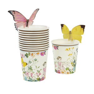 These paper cups are every little birthday fairy's dream!   Featuring a beautiful floral fairy setting design, these cups come with sweet butterflies to attach to the top of your cups, adding that extra touch of magic. A brilliant addition to your table if you're in search of fairy styled party ideas.   These cups look great with our Truly Fairy paper plates and napkins, to create a magical fairytale setting. Each pack contains 12 paper cups with butterflies in 2 different designs.