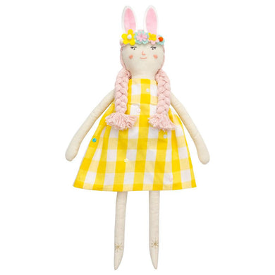 This is Alice, the newest member of the Meri Meri doll family. She is expertly crafted from calico and has pink yarn hair and sweet embroidered features. Stylishly outfitted in a yelllow gingham dress and wearing a fun floral bunny ears headband, she'll make a gorgeous gift for Easter!   Cotton with polyester filling Dressed in yellow gingham dress with floral bunny ear headband Stitched features with pink yarn plaited hair Gold thread detail Product dimensions: 7