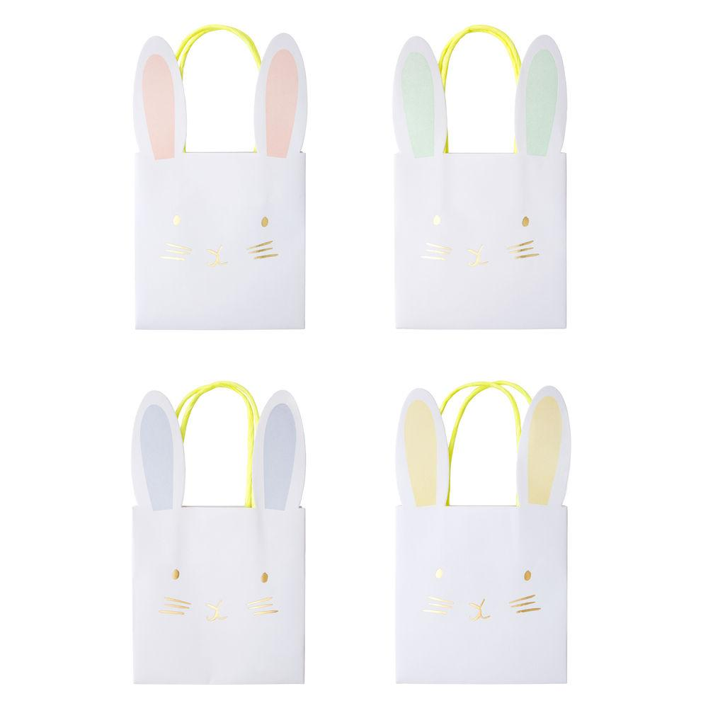 These sweet little bunny party bags are perfect to fill with yummy treats and gifts. Decorated with beautiful pastel colors, shiny gold foil details and striking neon yellow handles.   These bags are sold individually, assorted pastel colors (blue, pink, yellow and green)