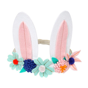 "This adorable bunny headband is perfect for Easter and Springtime dressing-up. Featuring a pair of cheeky felt bunny ears, embellished with colorful flowers, beautiful embroidered details and cheerful pompoms.    Felt ears  Gold glitter elastic  Velcro fastener Pack size: 8"" x 5"" x 0.7"""