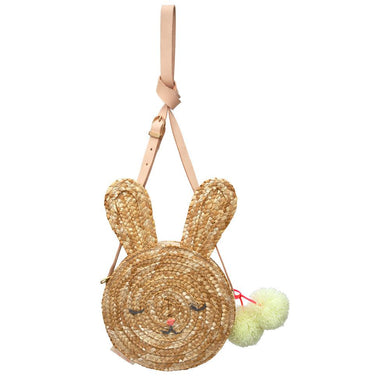 This gorgeous lined woven straw bag, with an adorable bunny face and sweet ears, is the perfect accessory for any little one. The bright pompoms and leather strap add stylish detail. A fantastic gift for Easter.  Cross body leather strap with brass buckle Zip closure Embroidered features & pompom detail