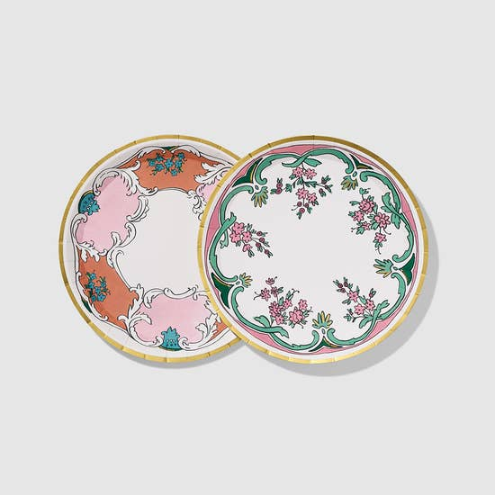 Coterie partnered with designer Molly Hatch to bring her bestselling styles to the party. Inspired by the surface patterns of 18th century European fine china and contemporary trends in fashion, Molly's Always collection is bright, fun, and timelessly unforgettable. These small plates feature her Camille and Marie designs dressed in coral, pink and green, with a touch of blue.  Each set includes:  10 plates, 5 of each design.  7.25