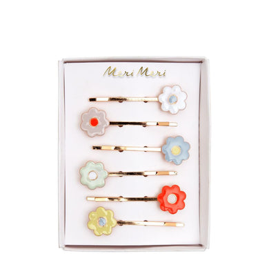 Add an instant touch of floral beauty to any hairstyle with these pretty Daisy Enamel Hair Slides. Crafted from pastel colored enamel with gold tone slides. Perfect as a Springtime gift.   6 colors Product dimensions: 2