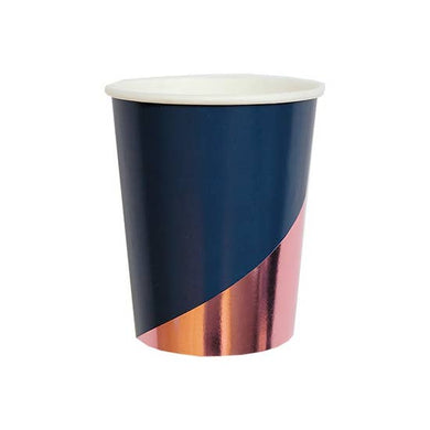 Gleaming in warm rose gold, our colorblock party cups make a bold statement with quiet confidence.  Colors: Navy, rose gold foil  Paper 9 oz   8 Cups / pack