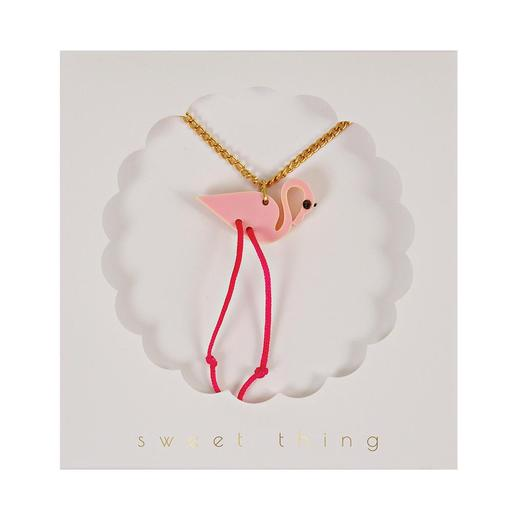 There's nothing quite like the pleasure of opening up a full jewellery box and rummaging through it for the perfect accessory... So whether you're looking for a treat for yourself, or a gift for a little girl (or a grownup one, for that matter), we've got you covered. This funky pendant necklace features a brilliant pink flamingo, embellished with dangling pink string legs on a shiny gold chain.   Pink acrylic pendant Neon cord legs Gold tone chain fastener