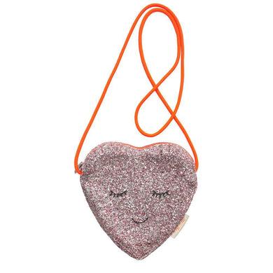 Looking for an accessory that is shimmery and fun? This gorgeous glittery pink heart bag has a sweet embroidered face and a bright coral cord handle. Perfect for special parties like Valentine's Day or an outing with friends.  Lined pink glitter fabric Cross body coral cord handle Coral zip closure Embroidered features detail  Product dimensions6.8