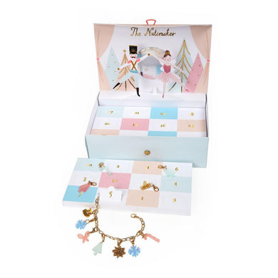 Count down to Christmas and build a beautiful Nutcracker charm bracelet this advent. Gorgeous charms are hidden behind the windows in the pretty jewelry box.   Jewelry box with festive charms behind 24 windows Gold tone chain bracelet 23 acrylic & tassel charms Gold detail