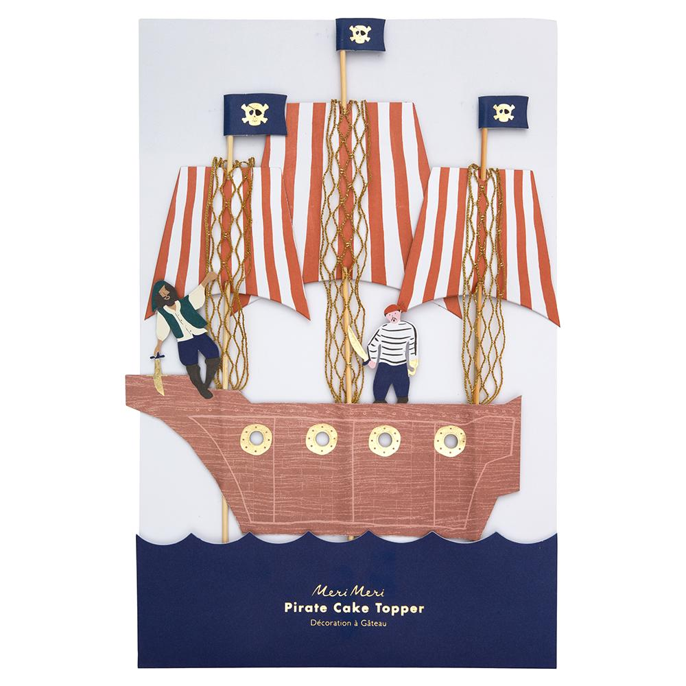 Why spend hours with icing when you can turn a cake into a pirate ship masterpiece with our sensational topper? Beautifully crafted with stripy sails topped with skull and crossbones flags, gold netting, and a cutlass-wielding crew.   Metallic gold netting Gold foil detail  Pack dimensions approx: 7.75 x 12 x 0.25 inches